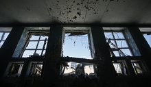 Damaged gymnasium is seen at a school in the village of Spartak outside Donetsk