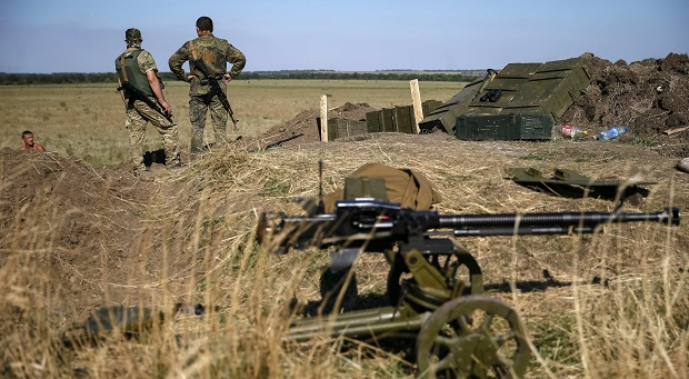 Ukrainian servicemen are seen at their positions near the eastern Ukrainian town of Luhansk