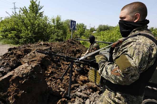 Pro Russian rebels man a position in eastern Ukraine